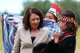 U.S. Sen. Maria Cantwell, D-WA, is given a blanket by young members of the Nisqually tribe during a dedication ceremony for the newly named Billy Frank Jr. Nisqually National Wildlife Refuge and Medicine Creek Treaty National Memorial, July 19, 2016.
