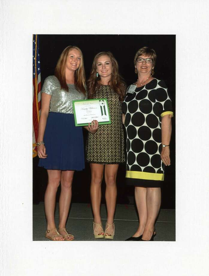 Kassidy Wilkerson (center) of Menard County 4-H is this year's recipient of the Bob Benson Memorial/4-H Excell Scholarship. It was presented at the Texas State 4-H Roundup at College Station in June by Elizabeth Lewis (left) and Shelia Lewis, granddaughter and daughter of the late Bob Benson, Hale County AgriLife Extension agent for agriculture.