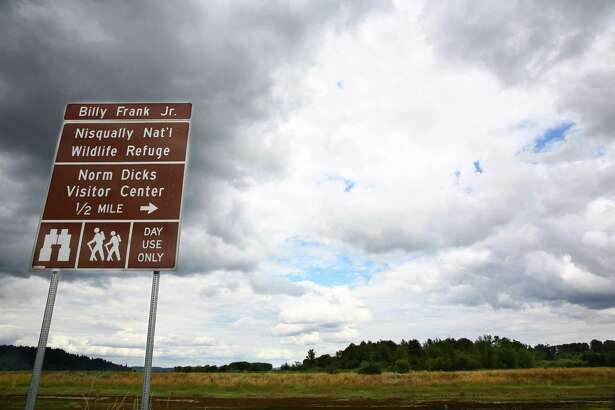 A sign designating the newly named Billy Frank Jr. Nisqually National Wildlife Refuge is seen off of Brown Farm Road NE, July 19, 2016.