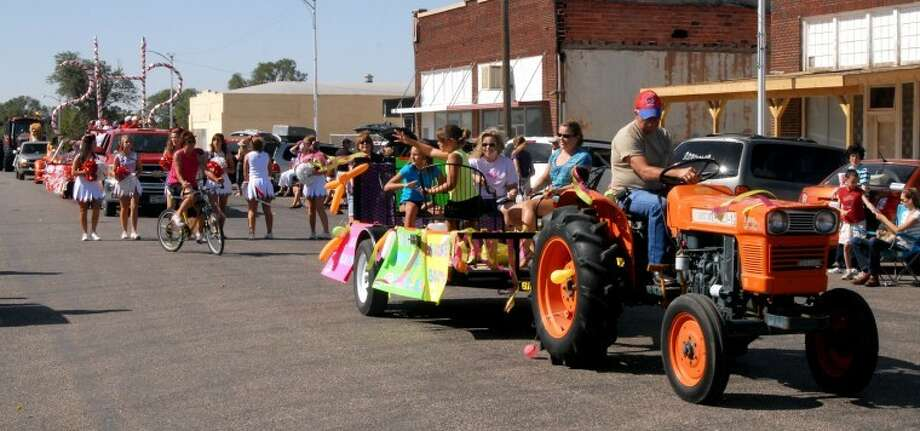 Floats, bicycle riders and high school cheerleaders make their way up the street Saturday during the Briscoe County Celebration parade in Silverton. Photo: Richard Porter/Plainview Herald