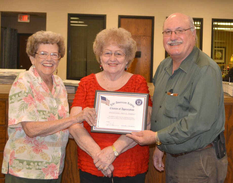 Betty Dykes (left) and Theta Vaughan, representing the American Legion and Legion Auxiliary, present a certificate of appreciation to Doug McDonough, Plainview Herald editor, in recognition of the newspaper's patriotism for prominently displaying the American flag on a daily basis. Ray Blackmore Post 260 recognized 10 local businesses on Tuesday with the special certificates as part of the organization's Program on Americanism. Eventually they hope to recognize each local business that consistently flies the American flag. Vaughan is immediate past president of the Legion Auxiliary and Dykes serves on its executive committee.