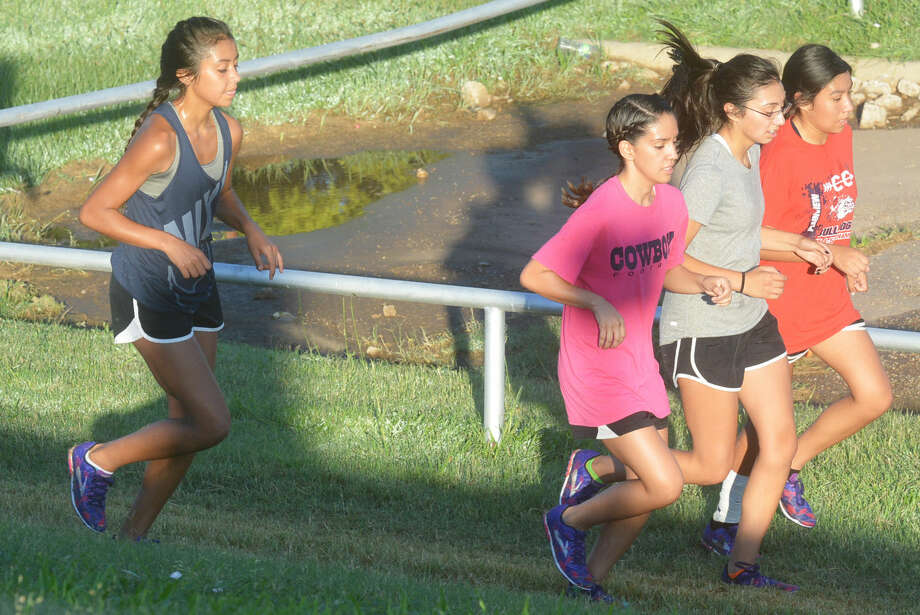 Plainview girls cross country runners jog together during a practice earlier this month. The Lady Bulldogs return six of their top seven runners from last year and are looking to win their second consecutive district championship and make a run at qualifying for the state meet. Photo: Skip Leon/Plainview Herald