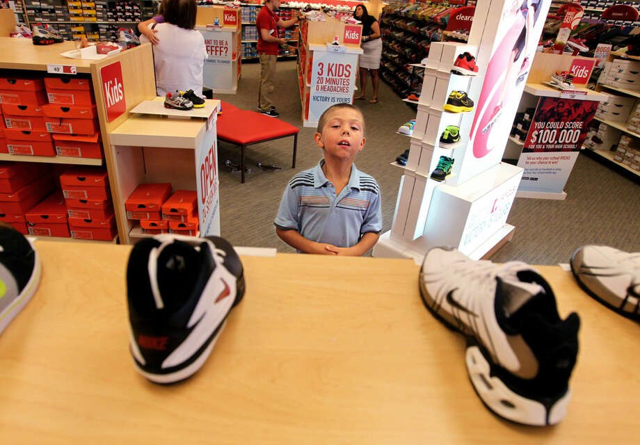 Isaiah Bush, 7, of Cedar Hill, browses the children's options of shoes at Famous Footwear store in Fenton, Mo., August 9, 2012. The shoe retailer has invested much energy in back-to-school shoppers. (Christian Gooden/St. Louis Post-Dispatch/MCT) Photo: Christian Gooden