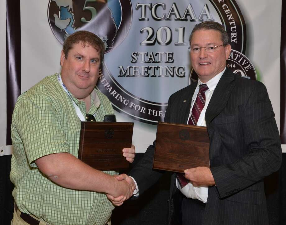 Robert Burns/Texas A&M AgriLife CommunicationsGary Cross (left), Texas A&M AgriLife Extension Service agriculture agent in Hale County, received the Texas Extension Specialist Award for Outstanding Agent from Regional Program Director Monte Dozier. Cross also won the Distinguished Service Award for Community Development from the Texas Extension Specialists Association.