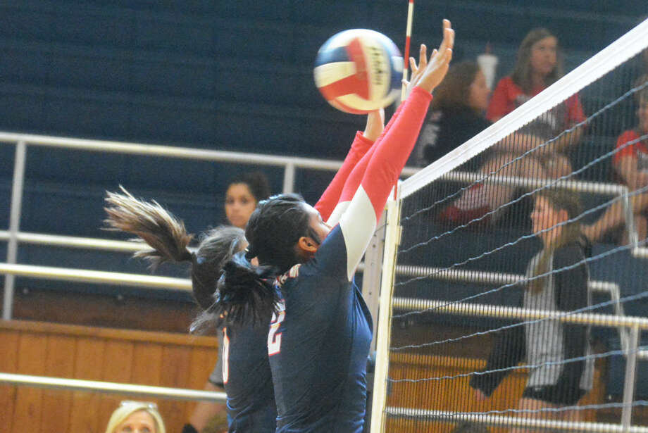 Plainview's Alondra Fraire (2) and an unidentified teammate attempt to block a shot during a volleyball match earlier this month. The Lady Bulldogs split six matches in pool play at the Eagle Mountain and Saginaw Tournament Thursday and Friday. Photo: Skip Leon/Plainview Herald