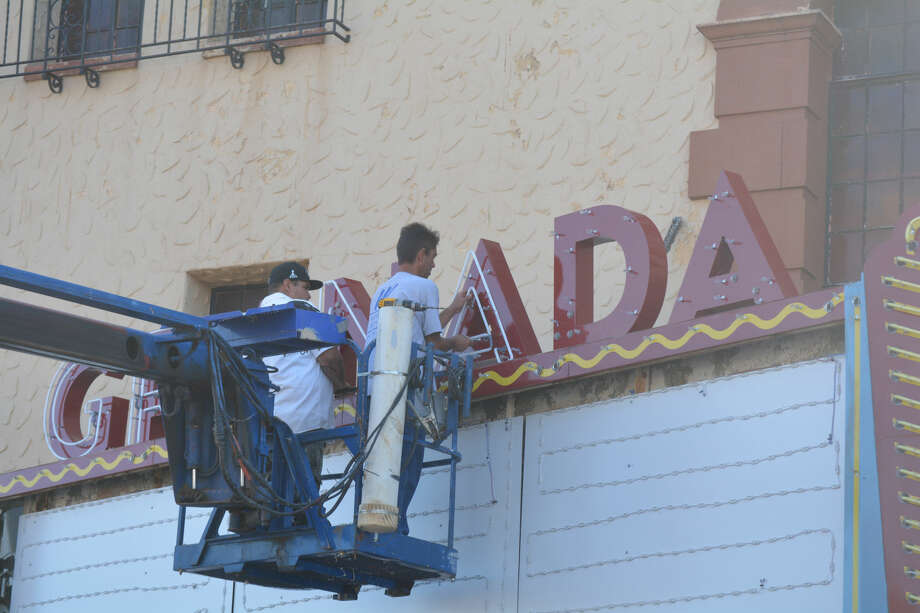 "Doug McDonough/Plainview HeraldSix weeks after they came down, the large metal letters spelling ""GRANADA"" are back in place atop the marquee of the downtown theater. This time they have twisted tubes of neon in place to illuminate the front of the building when it reopens for a four-day concert series over the Labor Day weekend. Crews from Willborn Sign Co. in Amarillo have been in Plainview this week installing the newly-renovated sign. They installed the letters with their neon early Wednesday afternoon. ""We're going to bring it back to its former glory,"" said CEO/President Michael Wellborn when he began the restoration in mid-June. The 1929 theater has been closed since the early 1990s. It will reopen Aug. 29-Sept. 1 for nightly concerts featuring Texas Tornados, Jason Boland and the Stragglers, Christian pop star Natalie Grant and Asleep at the Wheel."