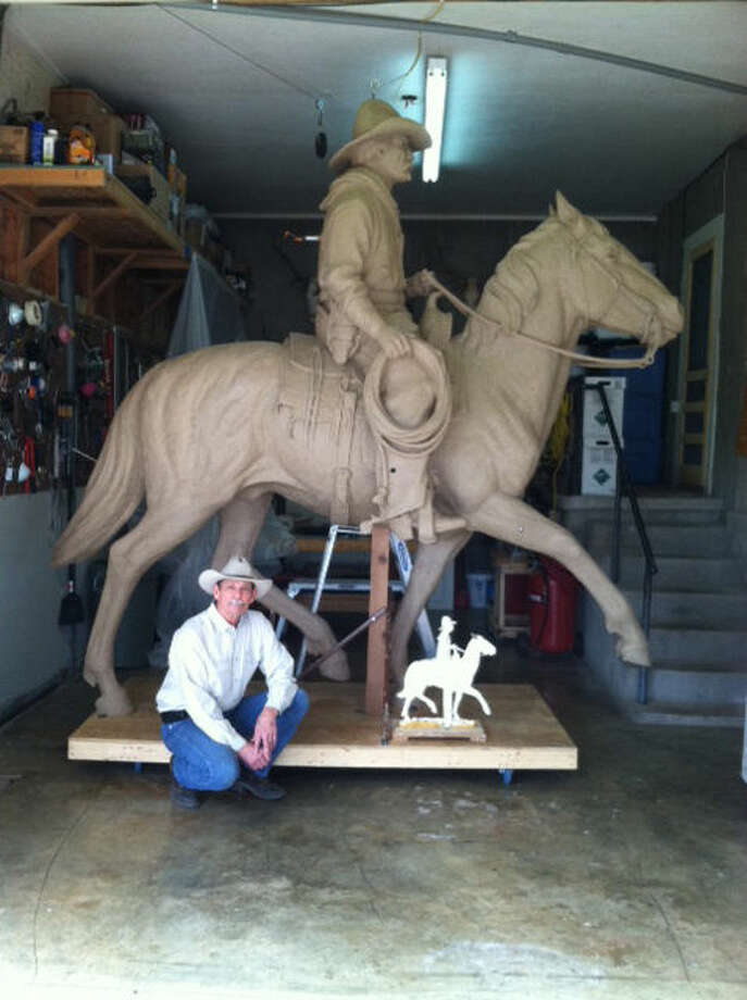 "Terrell O'Brien in his studio with the original clay model of a horse and rider, part of a larger work called ""The Stragglers"" that now stands on the University of Texas of the Permian Basin campus in Odessa. The artist is the father of David O'Brien, owner of Frames and Things on Broadway. Photo: Courtesy Photo 