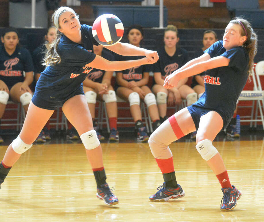 Plainview's Brooke Walker (left) and Meredith McDonough nearly collide as they move to return a serve during the Lady Bulldogs' opening scrimmage of the season against Levelland at the Dog House Friday morning. Plainview will jump into its regular season with two matches Monday and two more Tuesday. Photo: Skip Leon/Plainview Herald
