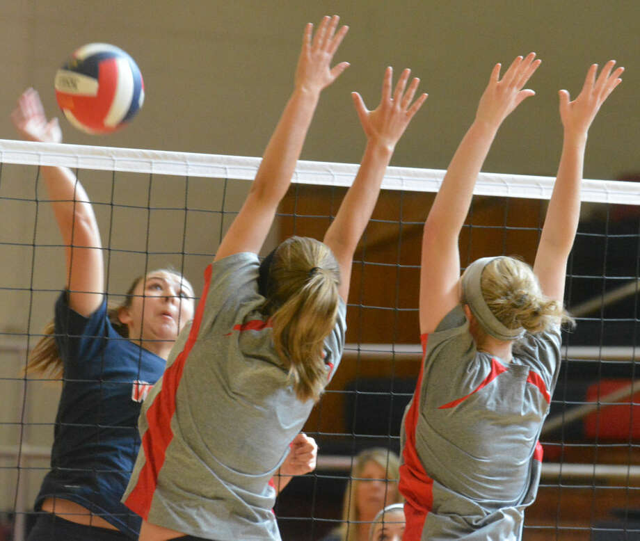 Plainview's Taryn Garza (left) hits the ball against two Levelland blockers during a volleyball scrimmage Friday. Garza had a combined 81 assists and 10 kills in matches against Levelland and Seminole Monday. Photo: Skip Leon/Plainview Herald