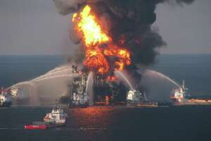 In this April 21, 2010 file photo provided by the U.S. Coast Guard, fire boat response crews spray water on the blazing remnants of BP's Deepwater Horizon offshore oil rig. An explosion at the offshore platform on April 20, 2010 killed 11 men, and the subsequent leak released an estimated 172 million gallons of petroleum into the Gulf of Mexico. (AP Photo/US Coast Guard, File)