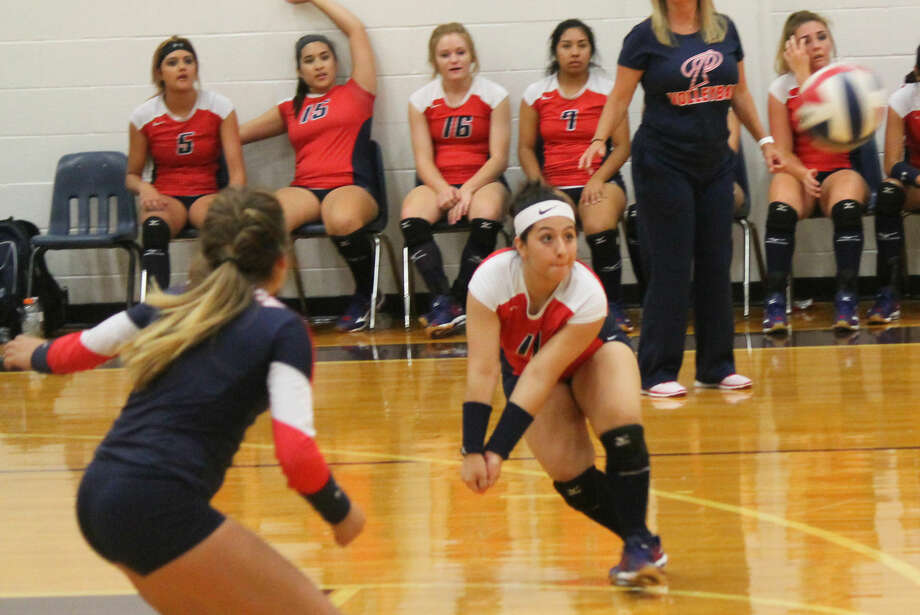Plainview defender Kaitlynn Sigala, right, lunges to return a hit as teammate Mariah Hernandez, left, looks on during a volleyball match at the Granbury Tournament. Hernandez was named to the all-tournament first team and the Lady Bulldogs won the consolation title of the Silver Bracket. Photo: Carmen Ortega/Plainview Herald