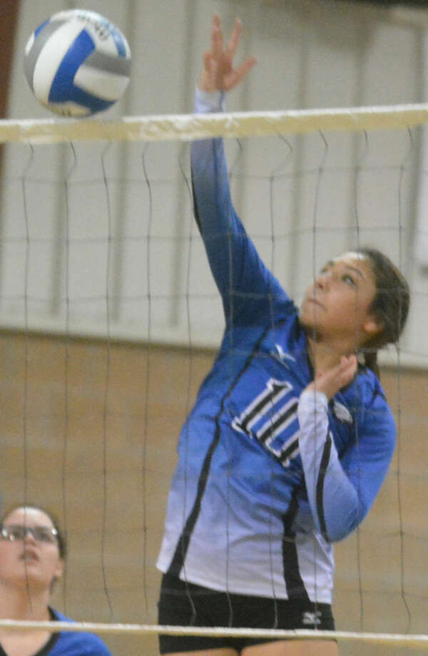 Plainview Christian Academy's Savannah Guzman goes over the net to send a hit toward the Southcrest side of the court during a non-district volleyball match at the PCA gym Tuesday. The Lady Eagles swept Southcrest in three games. Photo: Skip Leon/Plainview Herald