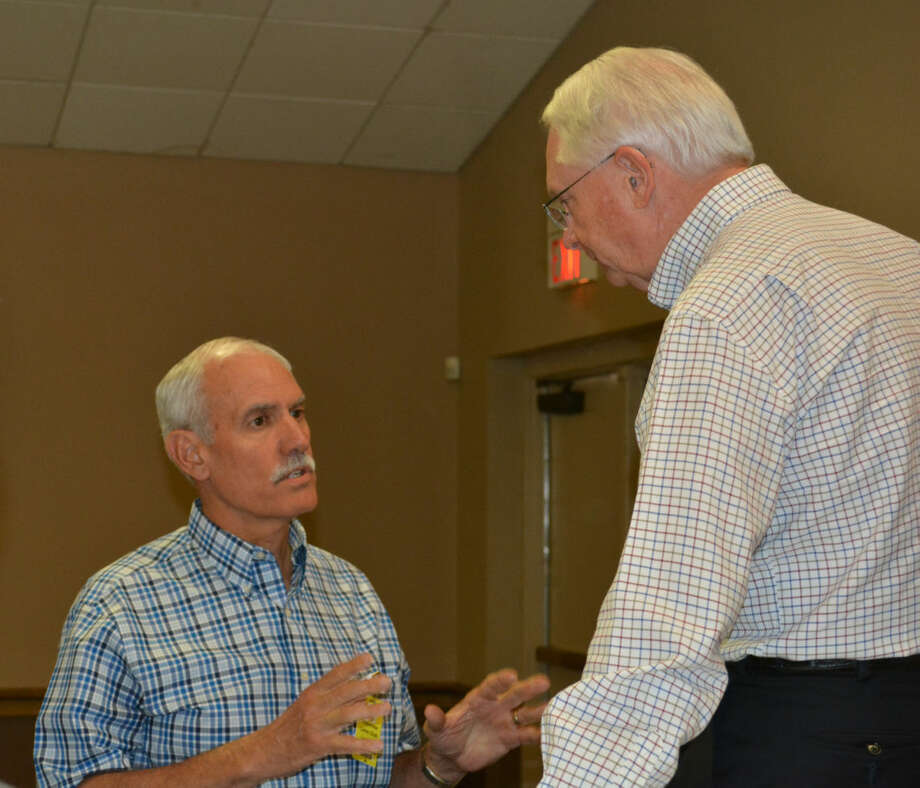 Doug McDonough/Plainview HeraldRealtor Cary Eaves (left) visits with U.S. Rep. Randy Neugebauer on Wednesday after the congressman spoke to the Plainview Lions Club. He also hosted an afternoon Town Hall Listening Meeting at the Plainview ISD Board Room.