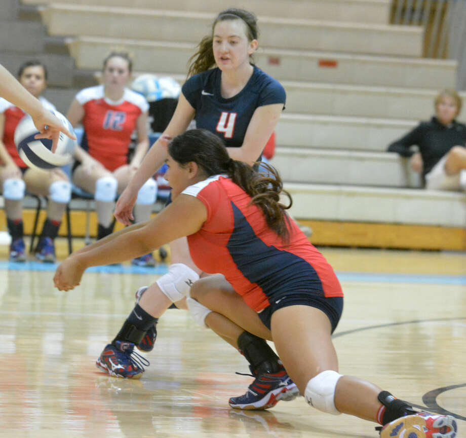 Plainview's Jackie Perez dives to dig out a hit as teammate Meredith McDonough (4) looks on during a volleyball match at Lubbock Monterey Tuesday afternoon. The Lady Bulldogs lost in three games to Monterey and also were swept by Tascosa. Photo: Skip Leon/Plainview Herald