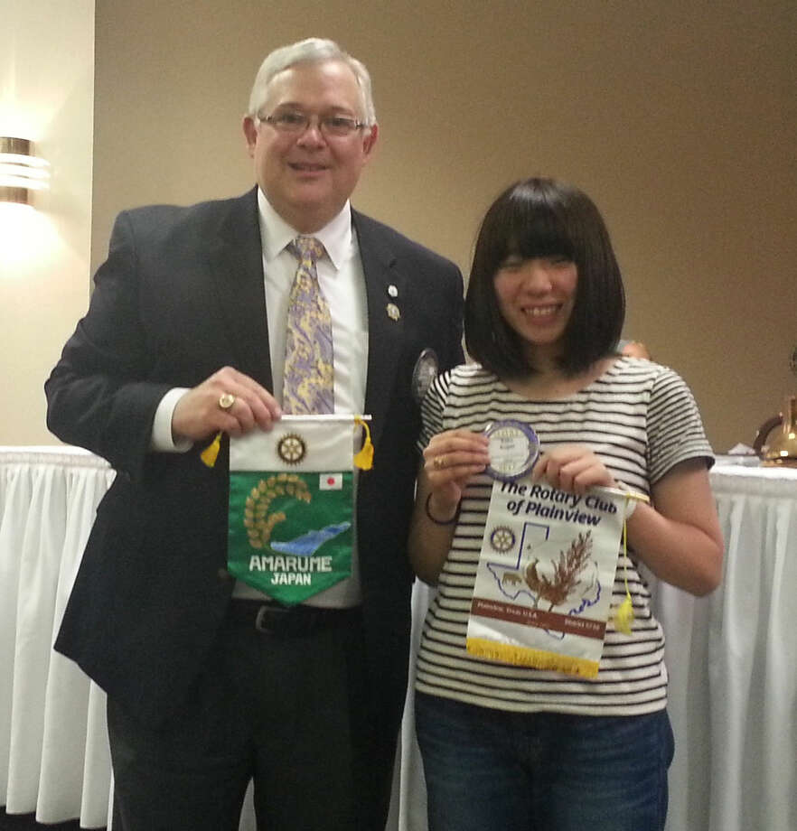 Plainview Rotary Club President Stan DeMerritt, at Tuesday's meeting, welcomes Rotary Youth Exchange Student Kako Sugae to Plainview with an exchange of club banners. Kako is from Yamagata, Japan, and will spend one year here. She is a senior at Plainview Christian Academy.