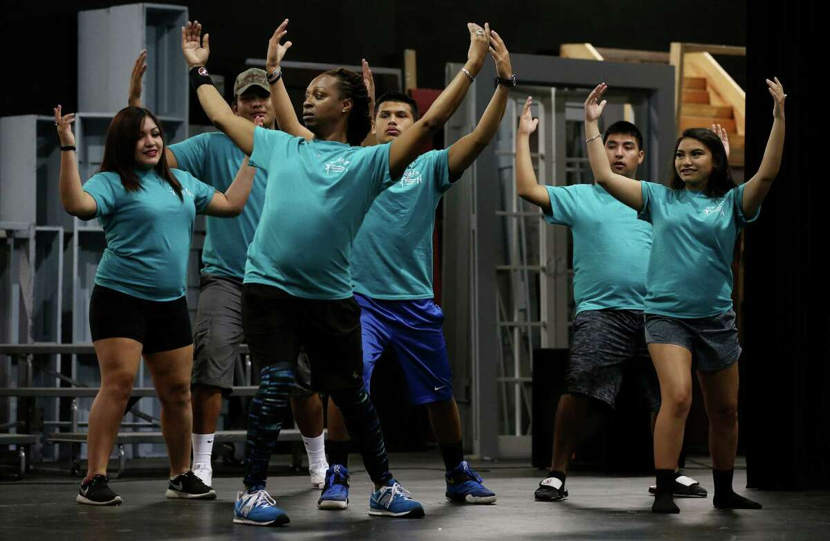 Instructor Mervin Primeaux-O'Bryant, center left, leads a group of students with the San Antonio Deaf Dance Company during rehearsal at the Marshall High School auditorium, Tuesday, July 19, 2016. The students will have their recital on July 29. The San Antonio Deaf Dance Company is celebrating its 20th anniversary. It's a leadership program for local middle and high school students who are deaf or hard of hearing. They have a month-long dance camp every summer. This year 33 students are in the program.