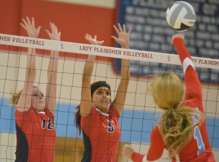 Plainview's Loren Johnson (left) and Harlee Davis (center) try to block a shot by a Lubbock Monterey hitter in a volleyball match earlier this week. The Lady Bulldogs gained their first victory of the season Thursday with a two-game sweep of Lake Worth at the Eagle Mountain-Saginaw ISD Tournament. Photo: Skip Leon/Plainview Herald