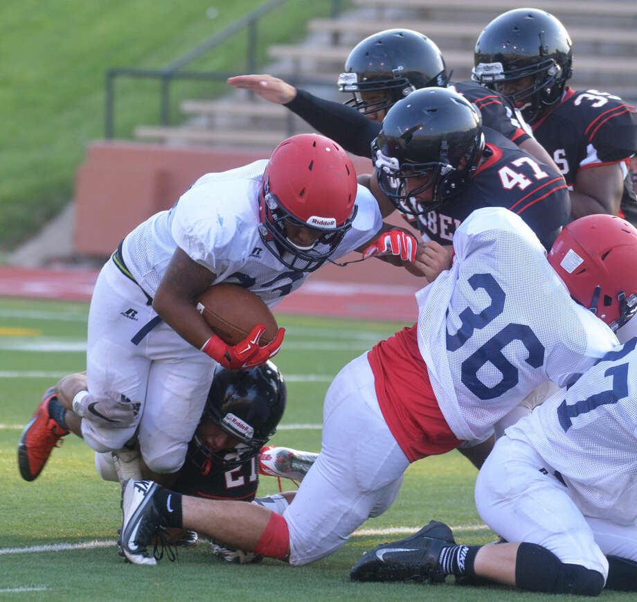 Plainview fullback Avery Rodriguez puts his head down and gains some tough yards in a scrimmage against Tascosa last week. The Bulldogs open their regular season at 7:30 p.m. Friday at home against Randall. Photo: Skip Leon/Plainview Herald