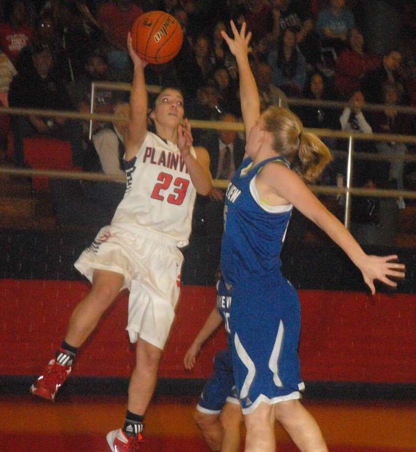 Plainview basketball player Karli Wheeler (23), shown driving to the basket in a game last season, has verbally committed to attend Oklahoma State. The 5-foot-8 point guard and shooting guard plans to sign a letter of intent during the early signing period in November. The three-time all-state player will enter her senior year at Plainview High School. Photo: Skip Leon/Plainview Herald