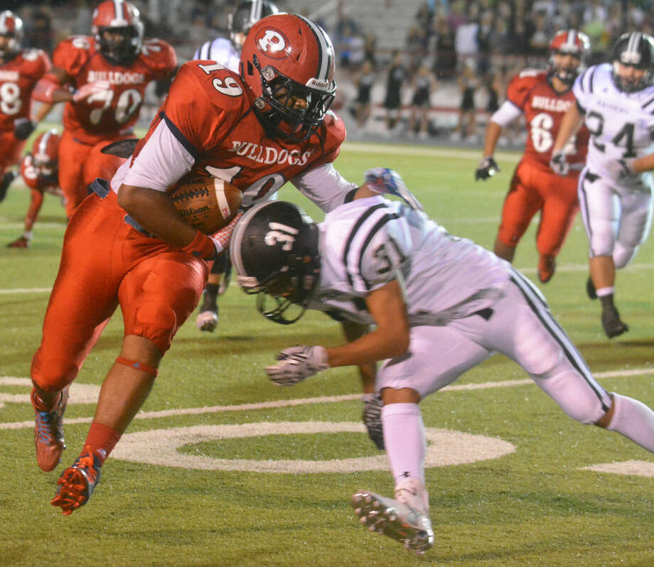 Plainview tight end Dontae Session rumbles for yardage after catching a pass as Randall's Isaac Torres moves in for the tackle during the opening game of the season Friday night at Greg Sherwood Memorial Bulldog Stadium. Photo: Skip Leon/Plainview Herald
