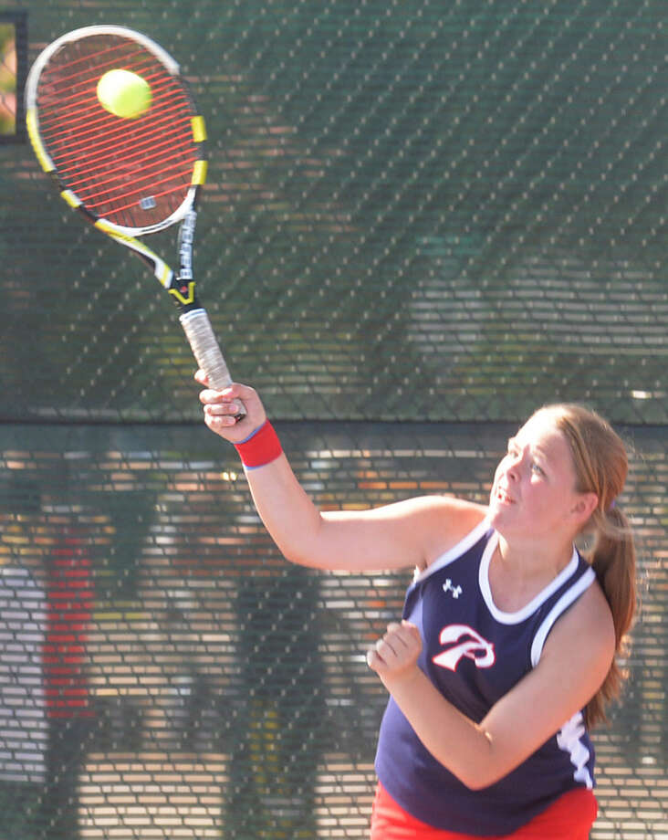 Plainview tennis player Misty Bass hits a hard serve during a match earlier this season. The netters flexed their muscles Friday and Saturday with four convincing victories over El Paso teams at Canyon High School. Photo: Skip Leon/Plainview Herald
