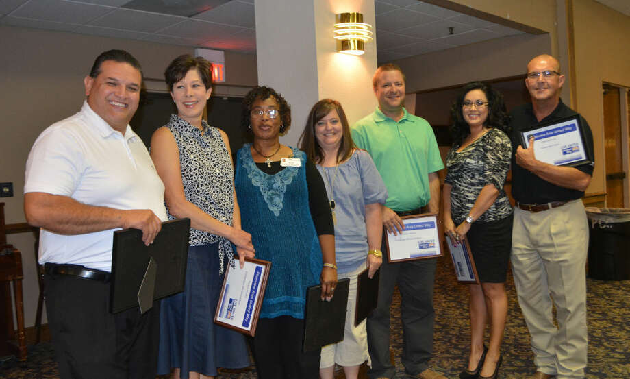 Plainview Area United Way President Chris LeFevre (right) recognizes Division Chairs Rick Garcia, Nancy Stukey, Sherrie Wall, Shannon Thornton, Brandon Ahrens, Carmen Ortega and (not shown) Doris Washington for a successful campaign in 2014 during Monday's kickoff of the 2015 drive.
