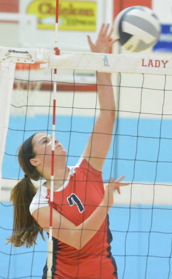 Brooke Walker takes a swing during a volleyball match earlier this season. The senior led the Lady Bulldogs with 33 kills in three matches Friday as they won two of three at the Eagle Mountain-Saginaw ISD Tournament. Photo: Skip Leon/Plainview Herald