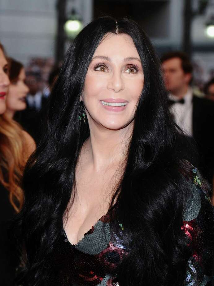 "Cher arrives at The Metropolitan Museum of Art's Costume Institute benefit gala celebrating ""China: Through the Looking Glass"" in this file photo from May 4, 2015, in New York. She will be in San Francisco on Sunday raising money for Democratic presidential nominee, Hillary Clinton. Photo: Charles Sykes / Invision"