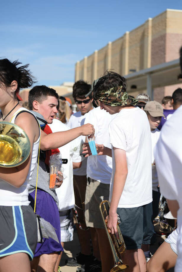 Canyon's senior quarterback, Cade McCallie (left) shares a Popsicle with band member Jordan McKillip Friday morning. Photo: By ASHLEY ELLER For The Canyon News
