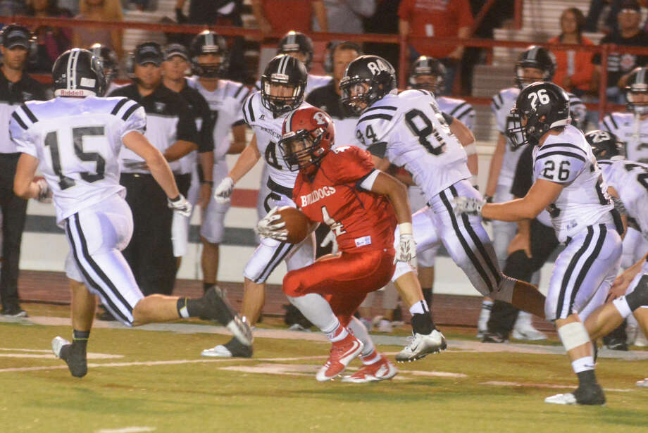 Plainview running back Trendan Jackson darts for yardage as a host of Randall defenders chase him. The Bulldog junior ran for 105 yards and scored both Plainview touchdowns in the opening game. He will be looking for another strong game when the Dogs host Palo Duro Friday night. Photo: Skip Leon/Plainview Herald