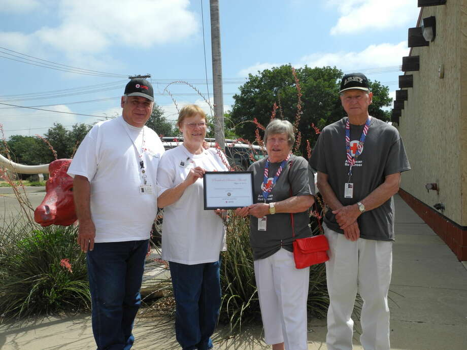 The American Red Cross South Plains Branch on Aug. 14 recognized four area workers with the President's Service Award for volunteering 500 or more hours in 2013. They are Stan Foster (left), Betty Foster, Ethel Chambers and Gerald Chambers. Photo: Gail M. Williams | Plainview Herald