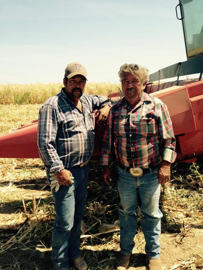 Espiridion Cervera, Sr., (right) and son Espiridion Cervera, Jr., continue a lineage of farming that spans two countries. Photo: Courtesy Photo
