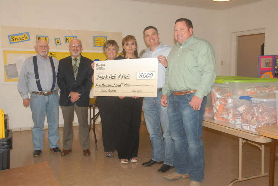 Cattle feeding company Cactus Feeders presented Hale Center's Snack Pak 4 Kids with a $5,000 donation Wednesday. Present at the presentation were (from left to right) volunteer Gary Bizzell, Hale Center Elementary principal Jackie King, Renee Rowell, Ana Rey, Cactus Feeders President Bradley Hastings and Hale Center Feedyard manager Jess Turner. Photo: Homer Marquez/Plainview Herald