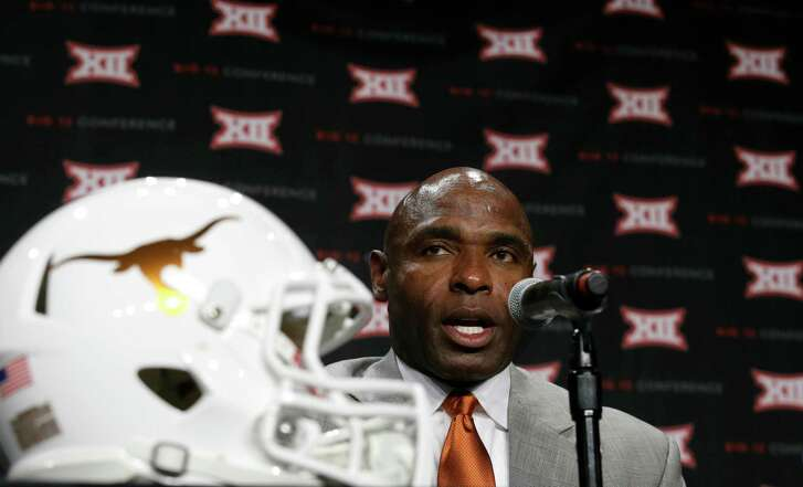 Texas head coach Charlie Strong arrives to speak to reporters during the Big 12 college football media days in Dallas on July 19, 2016.