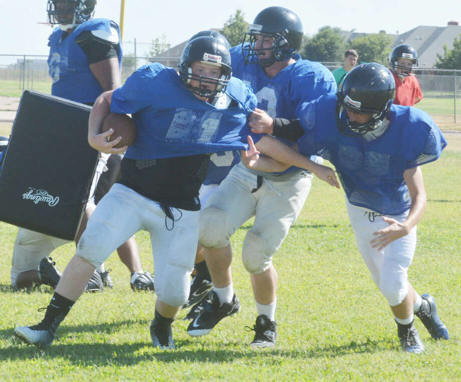 A Plainview Christian Academy running back breaks away from a tackler during an Eagles practice Tuesday afternoon. The Eagles held their own in a scrimmage against Whiteface and Kress last weekend. Photo: Skip Leon/Plainview Herald