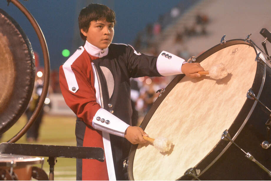 "BEAT GOES ONSkip Leon/Plainview HeraldJustin Godino, a percussionist in the Plainview High School Powerhouse of the Plains Band, awaits for the proper moment to strike his base drum while performing along the sidelines during halftime on Friday night. This year, the band is sporting new uniforms as it prepares for UIL Marching Contest, which will be held Oct. 17 at Lowrey Field in Lubbock. The PHS band will be shooting for its 78th consecutive Division I rating in UIL marching competition, a state and likely national record string of excellence dating to 1937 when the band was directed by R.C. ""Chief"" Davidson. The Powerhouse of the Plains is now directed by Anthony Gonzales. This fall, bands in Plainview's classification have the opportunity to advance to the area round of marching competition and on to state."