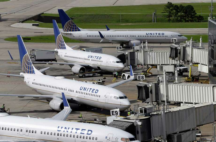FILE - In this July 8, 2015, file photo, United Airlines planes are parked at their gates as another plane, top, taxis past them at George Bush Intercontinental Airport in Houston.  (AP Photo/David J. Phillip, File) Photo: David J. Phillip, STF / AP