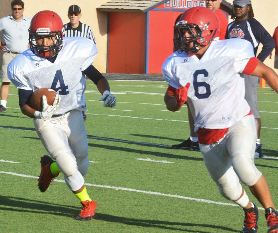 Plainview sophomore running back Trendan Jackson (4) gains yardage as teammate Domingo Saucedo (6) looks for somebody to block during a scrimmage against Tascosa last week. The Dogs play for real Thursday when they open their season against Randall at 7 p.m. at Kimbrough Stadium. Photo: Skip Leon/Plainview Herald