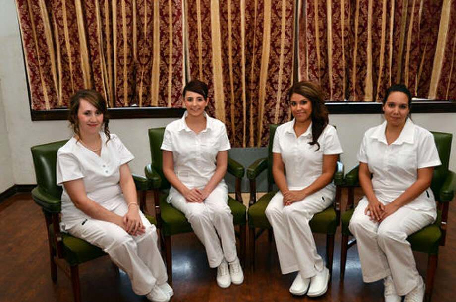 Wes Underwood/South Plains CollegeSouth Plains College Plainview Center recently pinned 14 Vocational Nurse Graduates during a pinning ceremony on Aug. 14 in the Fair Theatre. Shown from left are Amra Dizdarevic, Brittany Reyes, Kristi Gonzales and Jyra Manciaz, all of Plainview. Dizdarevic received the Florence Nightingale Award. Reyes was presented the Heart and Spirit of Nursing Award. Gonzales received the Nursing Leadership Award. Manciaz earned the Highest Score on the Nursing Test Predictor. Photo: WES UNDERWOOD