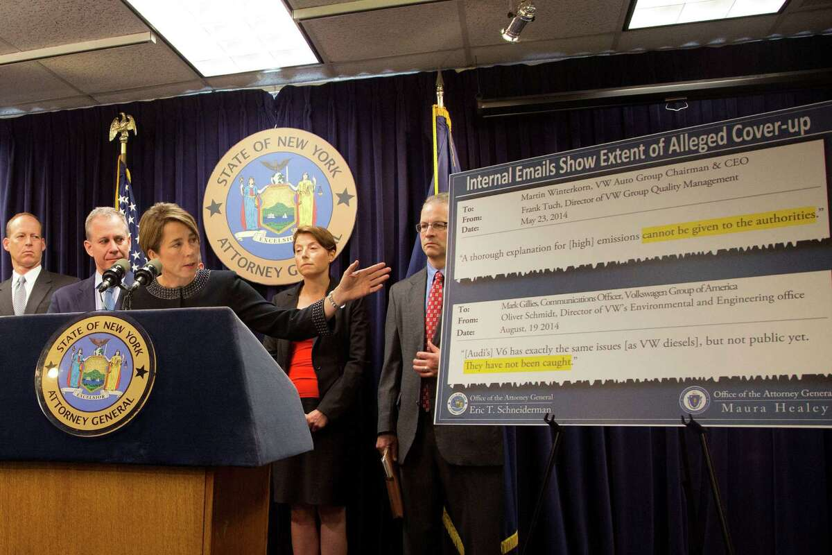 Massachusetts Attorney General Maura Healey points to an email displayed on a board while she discusses a lawsuit against Volkswagen, Tuesday, July 19, 2016, in New York. She is joined by New York Attorney General Eric Schneiderman, second from left. The states are suing Volkswagen and its affiliates Audi and Porsche over diesel emissions cheating, alleging that the German automakers defrauded customers by selling diesel vehicles equipped with software allowing them to cheat emissions testing. In response, the company said,