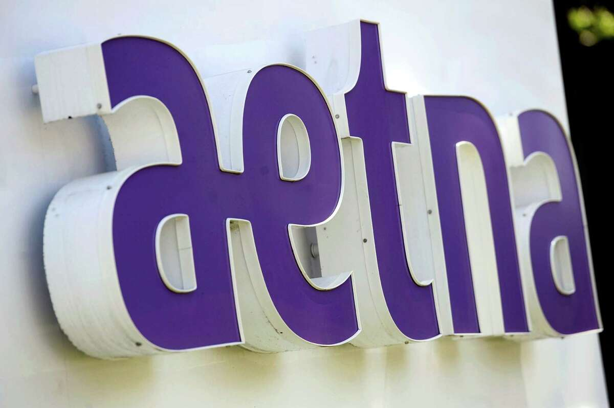 This Aug. 19, 2014, file photo, shows signage in front of Aetna Inc.'s headquarters in Hartford, Conn. Aetna Inc. reports financial results Thursday, April 28, 2016. (AP Photo/Jessica Hill, File)