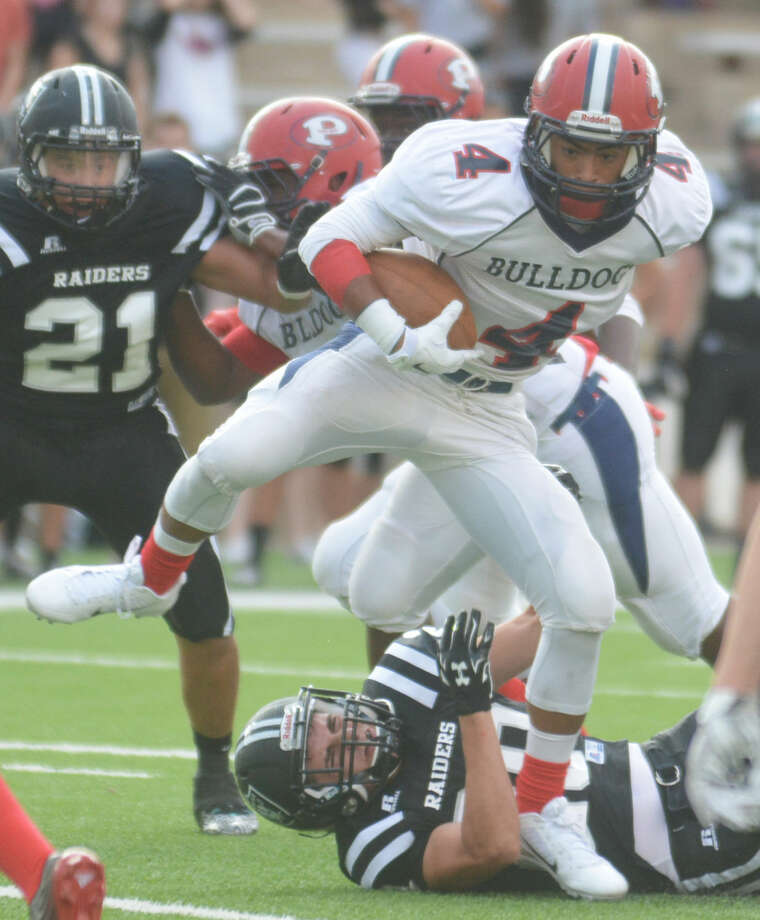 Plainview running back Trendan Jackson high-steps through the line during the Bulldogs' opening game of the season against Randall at Kimbrough Stadium Thursday night. The sophomore gained 108 yards on 13 carries in his varsity debut. Photo: Homer Marquez/Plainview Herald