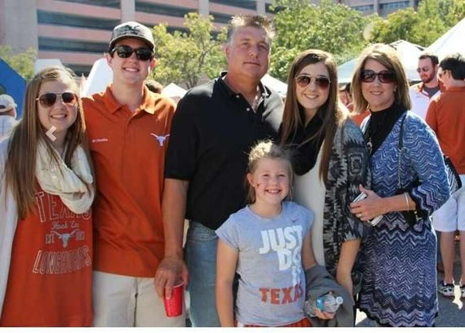 Petersburg farmer Tom Gregory (center) stands with family prior to a Longhorn football game. Photo: Courtesy Photo