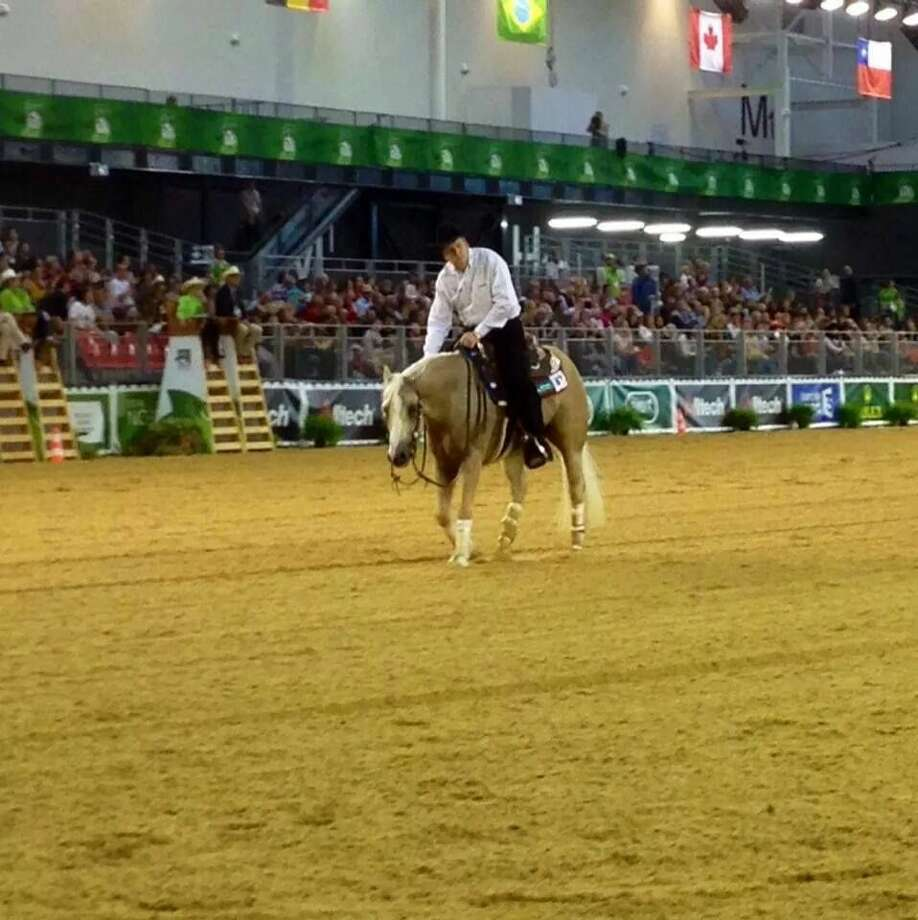 Two-time gold medalist Tom McCutcheon rides Dun Git A Nicadual in the World Equestrian Games in Normandy, France. The horse is owned by Jennifer and Jaci Marley of Plainview. Photo: Courtesy Photo