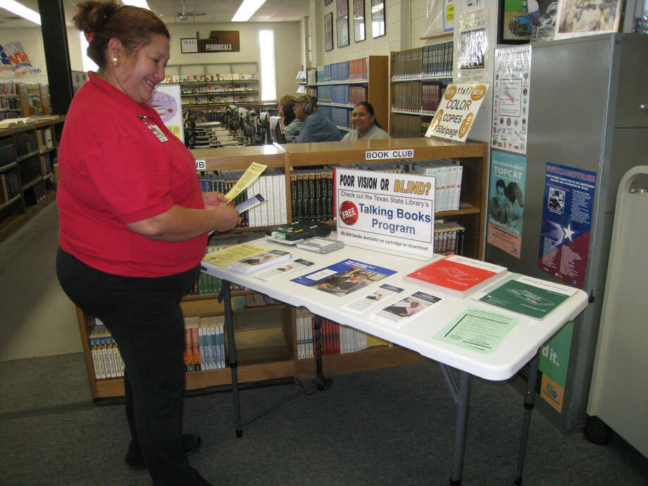 John Sigwald/Unger Memorial Library Photo Unger Memorial Library patron Norma Saenz peruses the library's display of the Texas Talking Book Program, sponsored by the Texas State Library.