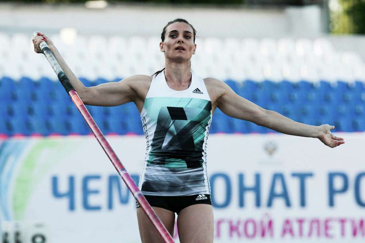 FILE - In this Monday, June 20, 2016 file photo Russia's pole vaulter Yelena Isinbayeva prepares for a jump at the National track and field championships at a stadium in Cheboksary, Russia. Yelena Isinbayeva is one of the Russian stars who could miss the Rio Olympics. (AP Photo/Nikolai Alexandrov, file) ORG XMIT: MOSB118