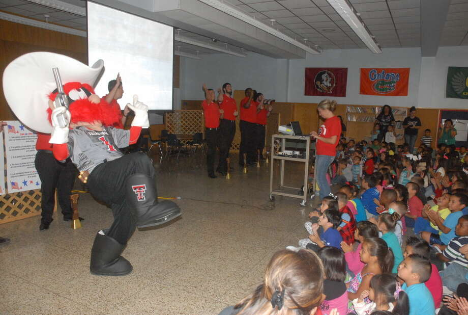 Texas Tech Saddle Tramps and mascot Raider Red fire up Thunderbird Elementary during a special program Friday. Photo: Homer Marquez/Plainview Herald