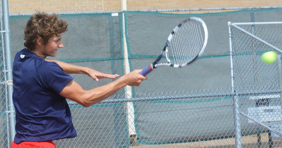 Plainview No. 1 boys singles tennis player Grant Thomas returns a forehand shot during a match earlier this season. Thomas outlasted his opponent in a tiebreaker to help the Bulldogs to a big victory over San Angelo Lake View in their opening District 4-5A match of the season Saturday. Photo: Skip Leon/Plainview Herald