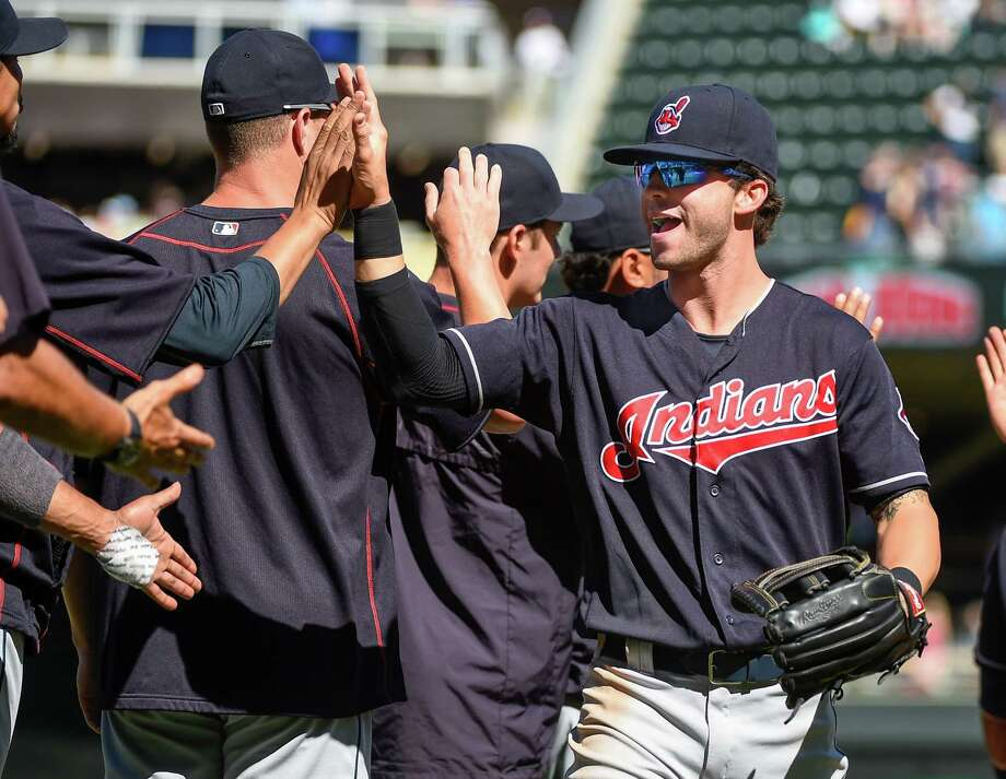 Tyler Naquin, right, has helped the Indians storm to the top of the American League Central by hitting .314. Photo: Craig Lassig, FRE / FR52664 AP