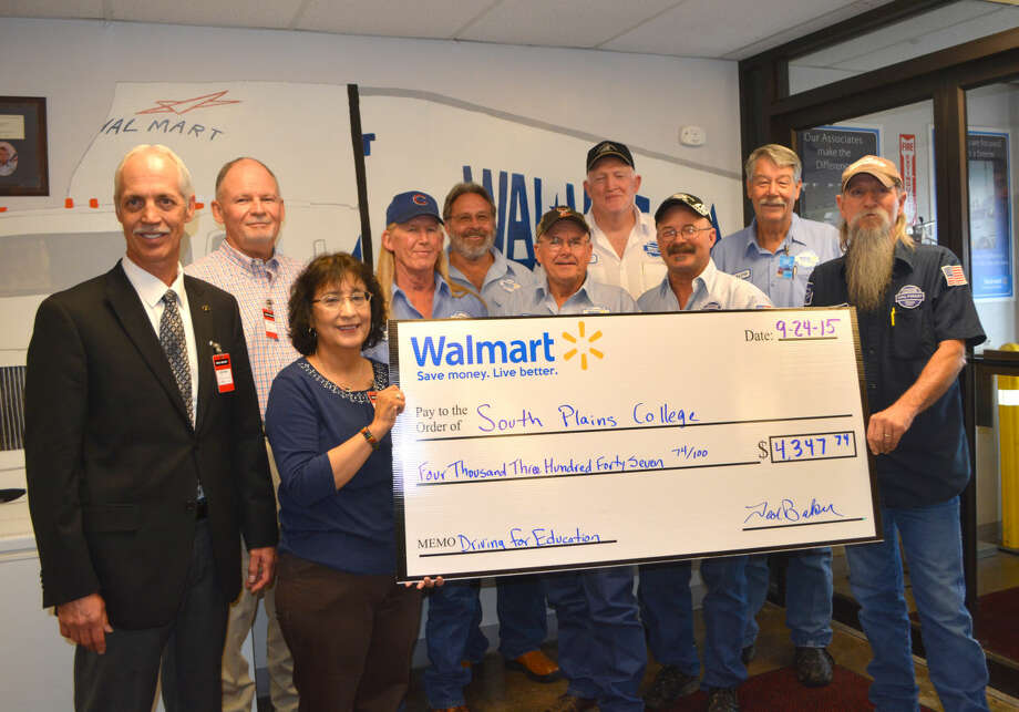 South Plains College-Plainview received $4,347.74, thanks to the safe driving exhibited by drivers in the Plainview transportation office at the Walmart Distribution Center. Taking part Thursday in a check presentation are South Plains College representatives Rob Blair (left), dean of technical education; Pete Stracener, chair of Industrial Technology Department; and Gracie Quinonez, SPC-Plainview director; along with seven local Walmart drivers who recently joined the elite group with 3 million miles of safe driving, Carroll Watson, Jack Speer, Floyd Requa, Kurt McCleskey, Brent Mink, Ralph Leonard and Don Armstrong.